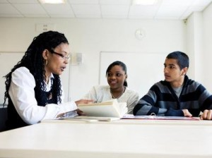 Student teacher help black classroom